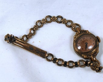 Gruen Veri thin 12 k gold filled ladies oval wrist watch with original band for repair or parts