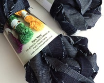 Recycled denim waste yarn. Denim ribbon, up cycled denim, knit, weave, fiber and textile arts. 50g