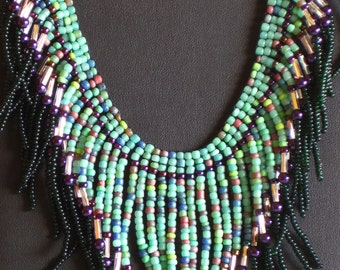 Native American necklace in purple, greens and silver