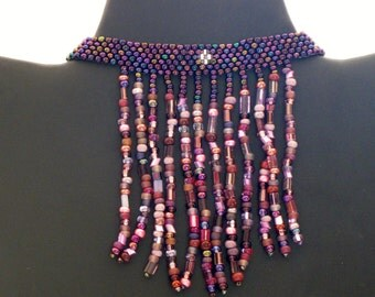 Native American beaded choker necklace in purples, pinks and silver
