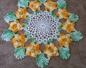 Vintage hand crochet dimensional orange flowers green leaves doily.   C5-342-.75