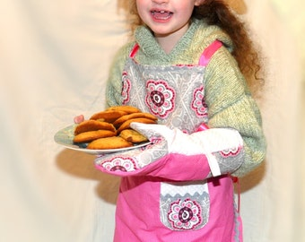 Child's apron, chef hat with oven mitt, pink