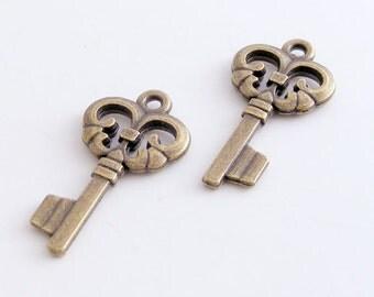 Antique Brass Skeleton Key Charm 12x23mm (12 pcs) MW-P3808