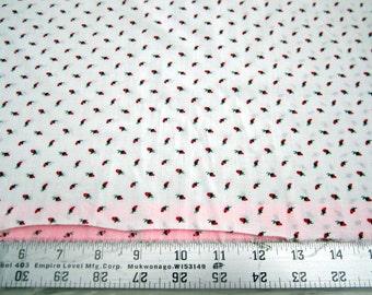 Dark Pink Rosebuds on White poly/cotton fabric