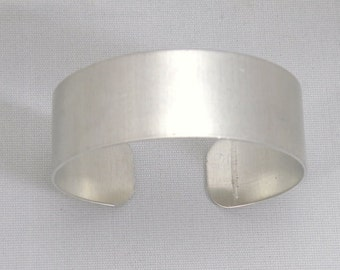 3/4 inch wide by six inches long, one dozen (12) Aluminum Cuff Bracelet Blanks