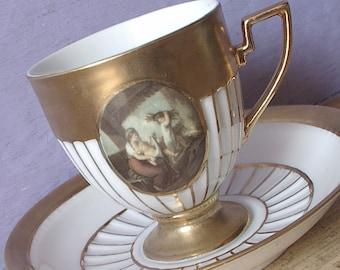 Antique German teacup and saucer, Gold tea cup, Porcelain tea cup, Antique teacup, Footed Gold and white china teacup, antique painting