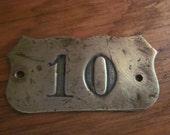 old brass hotel room number 10, brass plaque