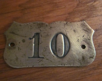 old brass hotel room number 10, brass plaque