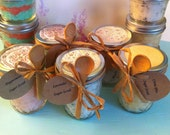 Essential oil sugar scrubs in 8oz mason jars..you pick the scent (lavendar scrub featured in photo). Crocheted cover and spoon sold seperate
