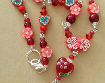 Sale was 18 now 16uk Red Blossom Faux Milli Fiori Necklace .