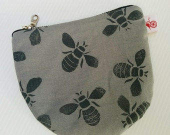 Hand printed bees on linen zip purse