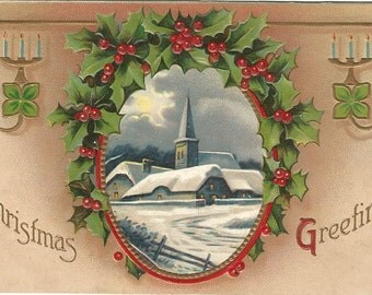 Snow Covered Church Scene with Frame of Holly and Berries Christmas Greetings Vintage Postcard