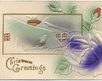 Snow Covered Rooftops and Purple Rose Decorate this Christmas Greeting Heavily Embossed and Airbrushed Novelty Vintage Postcard