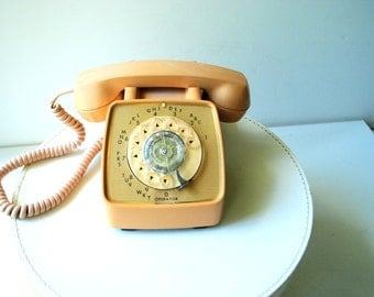 Mod vintage 60s muted beige,tan, butterscotch color , heavy plastic,rotary dial telephone.