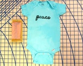 Sky blue hand stamped Peace onesie, 24 months. 100% cotton. R021