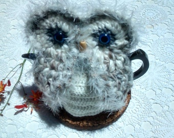Owl teapot cozy in light grey, cream & white wool and acrylic yarns for medium to large pot.