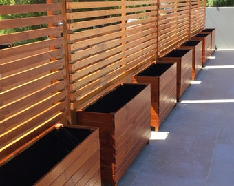Slimline timber garden planter box for balconies terrace for Outdoor privacy screen on wheels