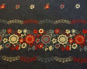 Vintage Fabric - dark blue denim look, wide machine embroidered border of red, white & light blue stylized flowers, apron project, sewing
