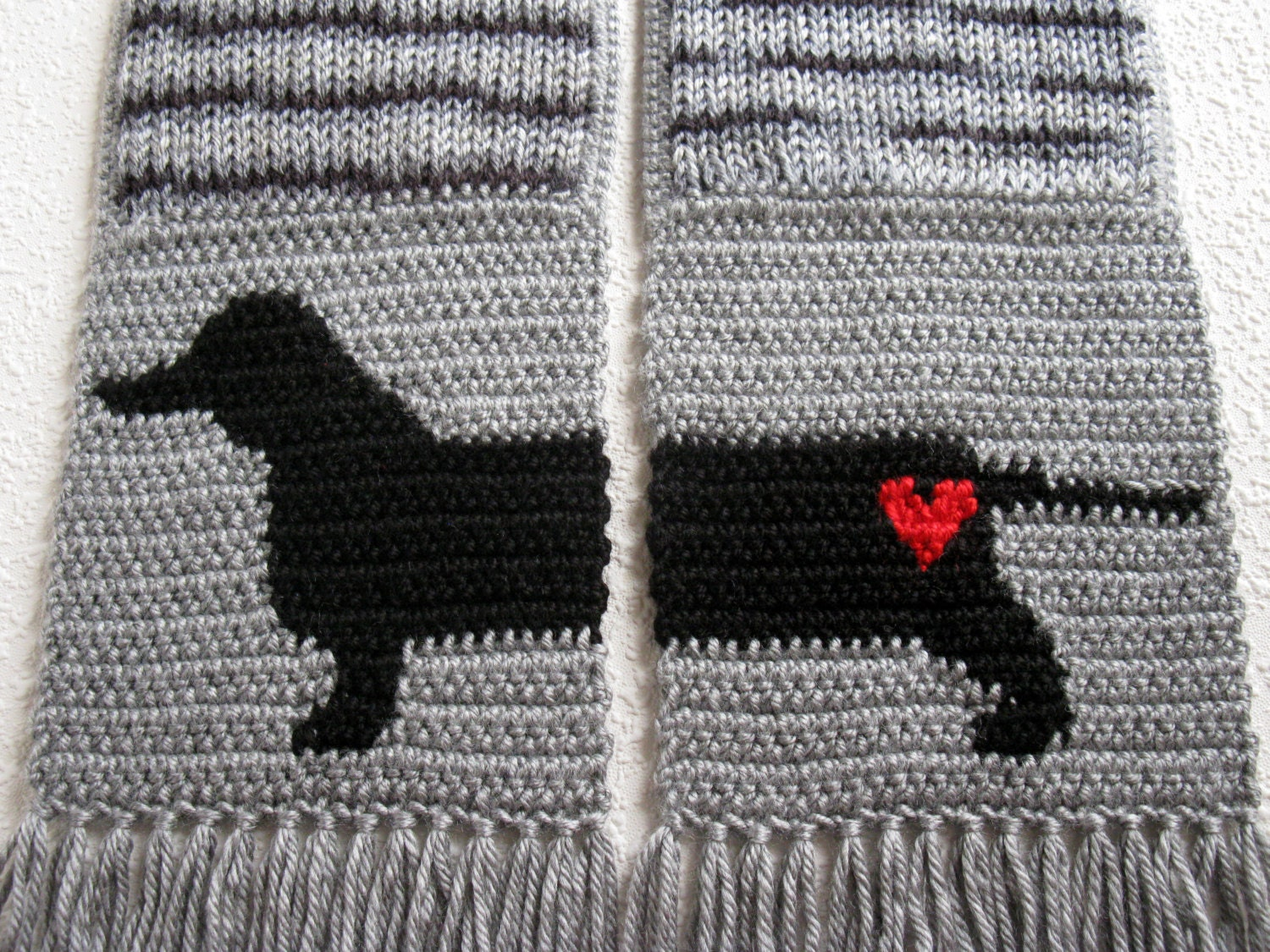 Knitted Dachshund Pattern : Knit Dachshund Scarf. Gray striped knitted scarf with a