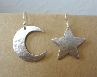 "Sterling silver asymmetrical hand cut and hammered ""mis-match"" earrings. One star & one moon earring set. Unique women's earrings, 1"" long."