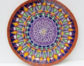 ceramic wall art; ceramic flower plate; ceramic art; ceramics and pottery