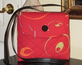 Green, Orange and Blue Swirls on a Burgundy Background with Front Velcro Flap Closure Quilted Crossbody/Shoulder Bag