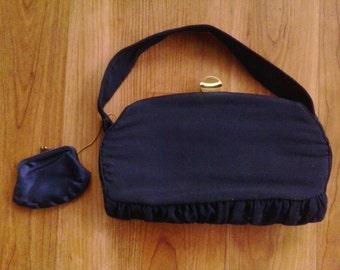 60s black evening handbag with matching coin purse inside. By Garay