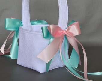 White lace wedding flower girl basket with aqua and pink ribbons