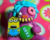 Purple Minion Eater. Minion Charm holding Miniature Button Eye Voodoo Doll. Hand sculpted, Polymer clay.