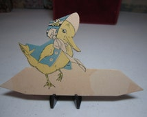 Darling unused 1920's die cut Buzza easter place card yellow duckling dressed in a bonnet and matching vest