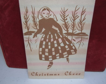 Pretty 1920's-30's art deco christmas card young lady ice skating on pond striped multi colored pink, blue, light brown design on paper