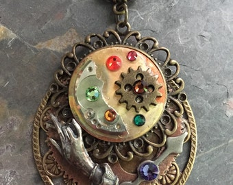 STEAMPUNKALICIOUS PENDANT #4...steampunk..watch parts..victorian..swarovski crystals..handmade..metal..glas beads.. antique gold