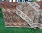 Vintage Pendleton Woolen Blanket in elegant earth tones of a Native American Indian design concept in Near Mint Condition, Robes and Shawls