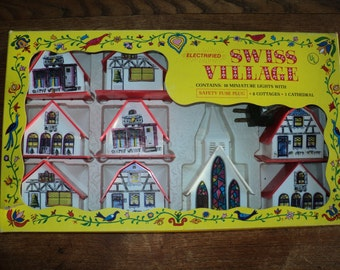 Vintage Swiss Village of 8 plastic cottages and A Cathedral with a light set contained in the original box packaging,  Retro Christmas Decor