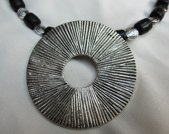 BOLD Dynamic Antique Silver Circle Pendant set on Black and Antique Silver Beaded 18 Inch Necklace with a Sturdy Magnetic Clasp