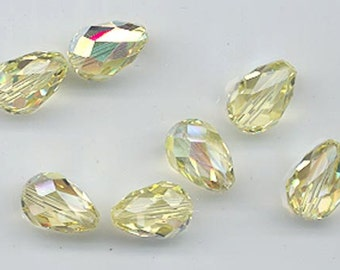 Twelve vintage Swarovski crystal beads - Art. 5500 - 12 x 8 mm - jonquil AB