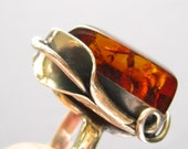 "SALE Sterling Artisan Ring c. 1980. Calla Lily Is Part of its Silver Setting with a Large Amber (Resin I think) Focal ""Stone"".   Sz. 7.25"