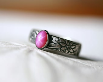 Oval Ruby Star Sapphire and Sterling Silver Ring on Floral Pattern Band in Antique Silver Finish
