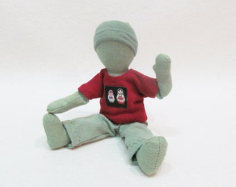 """Green pocket doll, 7"""" gender neutral doll, stacking dolls, green and red doll, travel size cloth doll, faceless doll, natural fiber doll"""