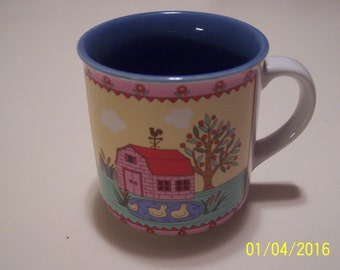 Barn and Ducks on a Pond Cup