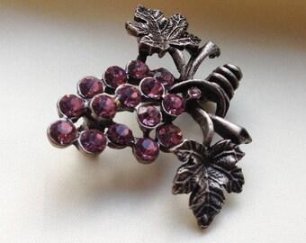 Grape cluster brooch.