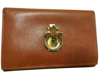Vintage Salvatore Ferragamo brown leather long wallet with gold tone gancini closure. Holds lots of things.