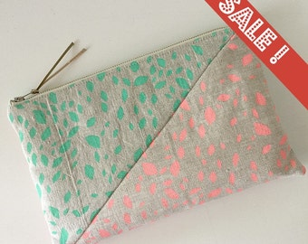 Linen zippered purse, hand printed, screen print, mint green and coral orange geometric seam