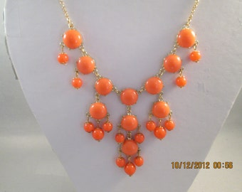 Gold Tone and Orange Bib Necklace on a Gold Tone Chain
