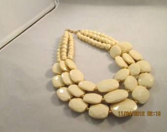 3 Strand Ecru Bib Necklace with Gold Tone Spacer Beads