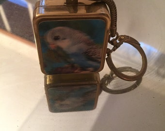 Vintage parakeet key chain with music box