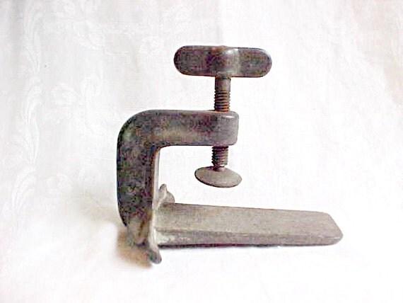 Unusual vintage metal clamp sits flat or hangs wing screw