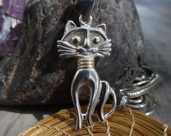 Love my cat pendant. Sterling silver and 18k gold field.