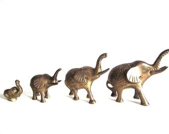 set of four vintage brass ornate elephants