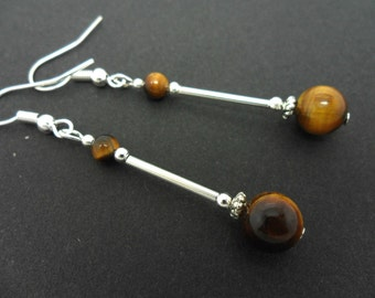 A pair of pretty tigers eye  bead  dangly earrings.